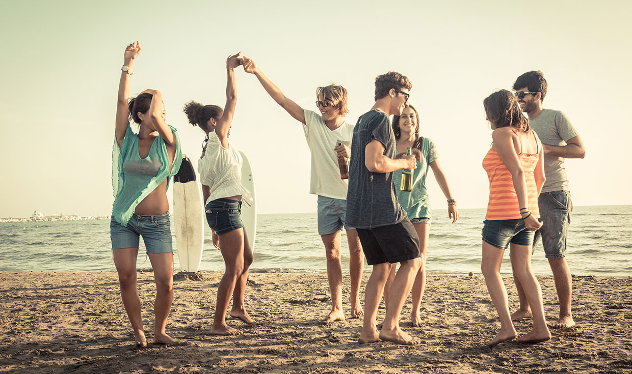 Group of people on the beach dancing